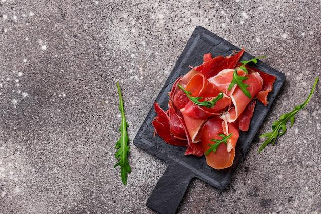 Traditional spanish cured meat jamon Premium Photo