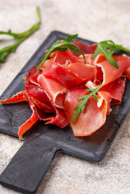 Traditional spanish cured meat jamon Premium Photo