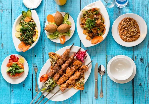 Traditional syrian cuisine, kebab and shish taouk Premium Photo