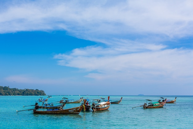 Traditional thai fishing boats wrapped with colored ribbons. Premium Photo
