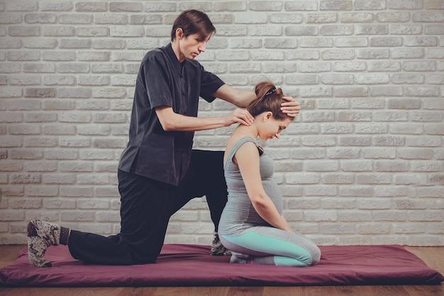 Traditional thai massage of a pregnant woman Premium Photo
