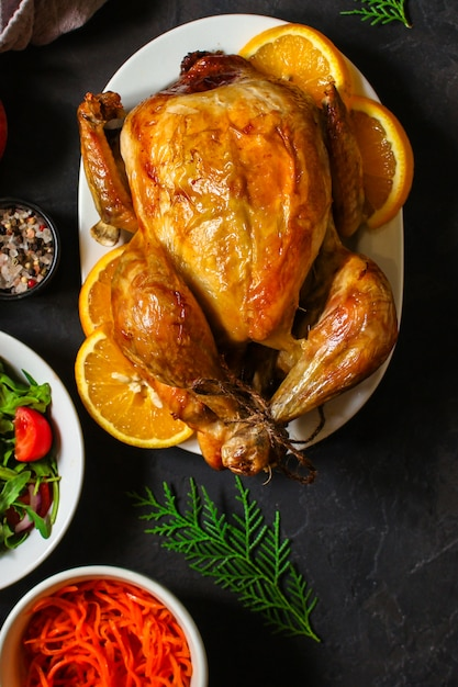 Traditional thanksgiving day chicken or turkey, christmas festive table setting food table, a lot of dishes menu . food . copyspace. top view Premium Photo