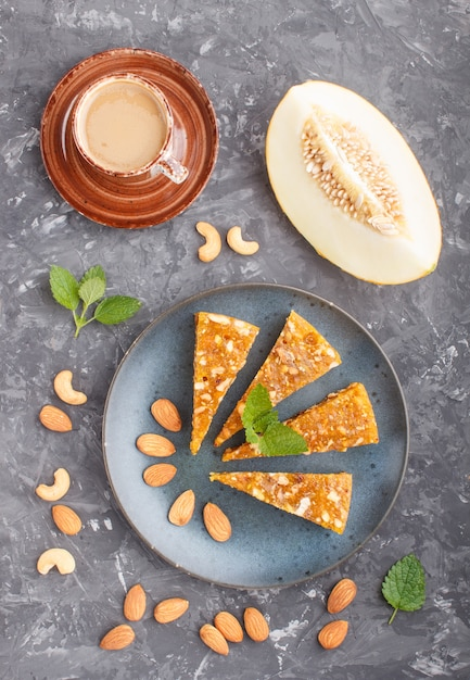 Traditional turkish candy cezerye from caramelised melon in blue plate Premium Photo