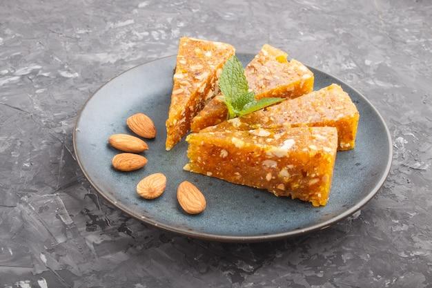 Traditional turkish candy cezerye made from caramelised melon, roasted walnuts, hazelnuts, pistachios Premium Photo
