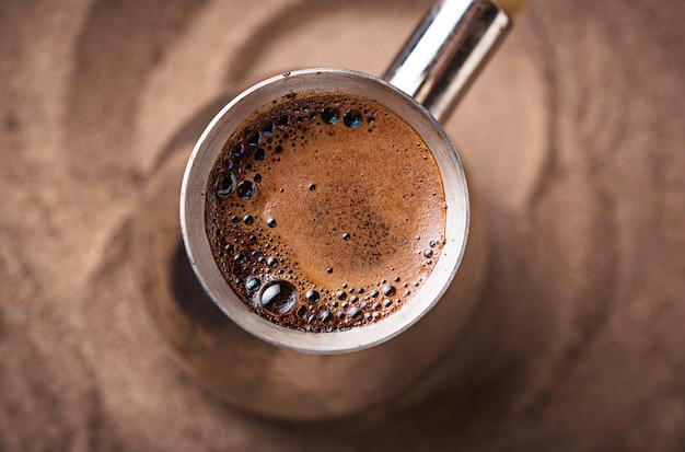 Traditional turkish coffee in cezve Premium Photo