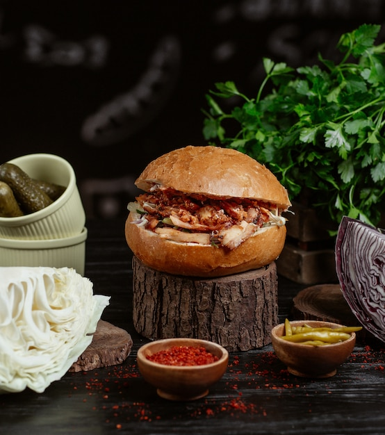 Traditional turkish kebab burger, bread bun stuffed with grilled meat and vegetables. Free Photo