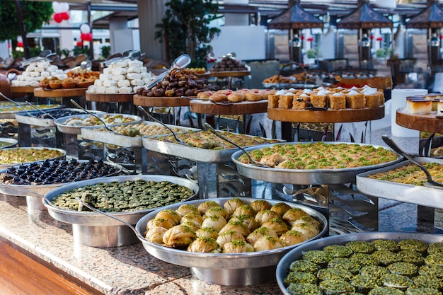 Traditional turkish sweets in the open buffet in a hotel in turkey Premium Photo