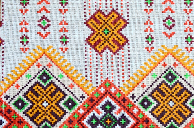 Traditional ukrainian folk art knitted embroidery design on textile fabric Premium Photo