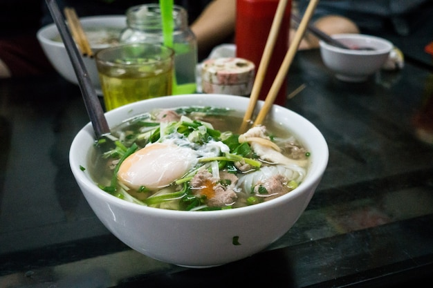 Traditional vietnamese pho bo noodle soup with egg Free Photo