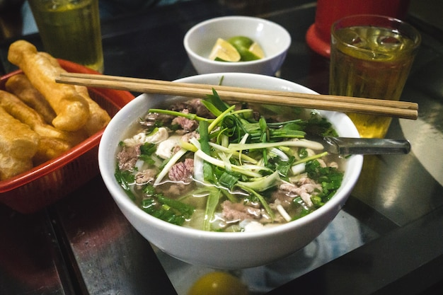 Traditional vietnamese pho bo noodle soup Free Photo