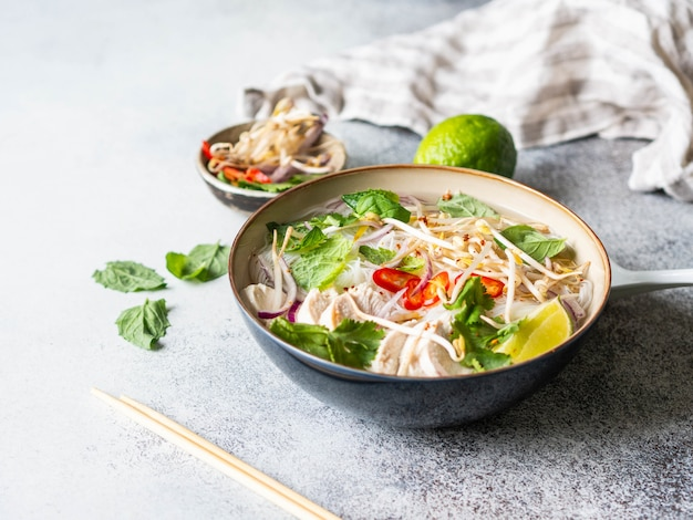Traditional vietnamese soup- pho ga in bowl with chicken and rice noodles Premium Photo