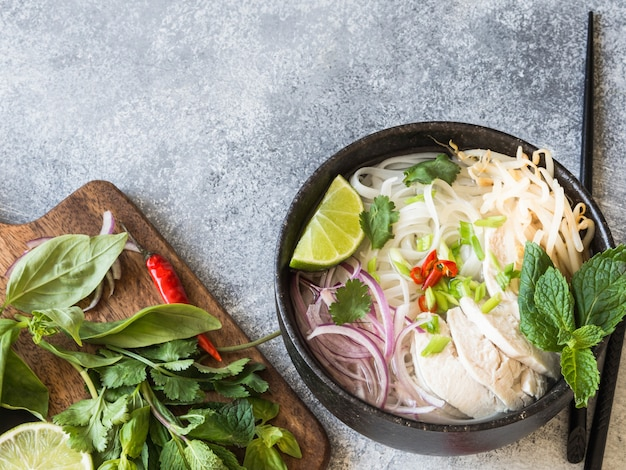 Traditional vietnamese soup- pho ga  with chicken and rice noodles Premium Photo