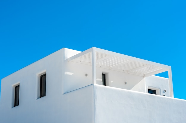 Traditional white home in the blue sky of santorini Premium Photo