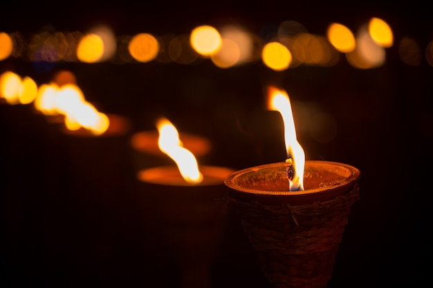 Traditional wooden torch flame at night Photo | Premium Download