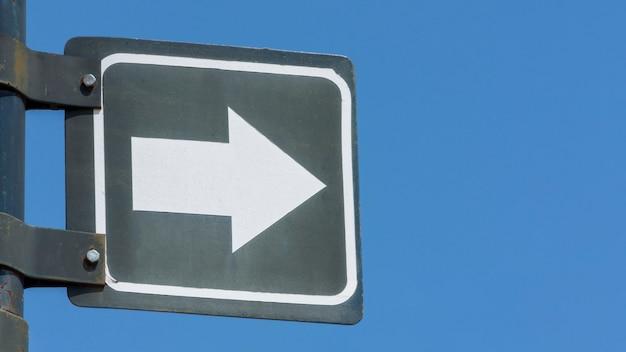Traffic arrow sign on a pole Free Photo