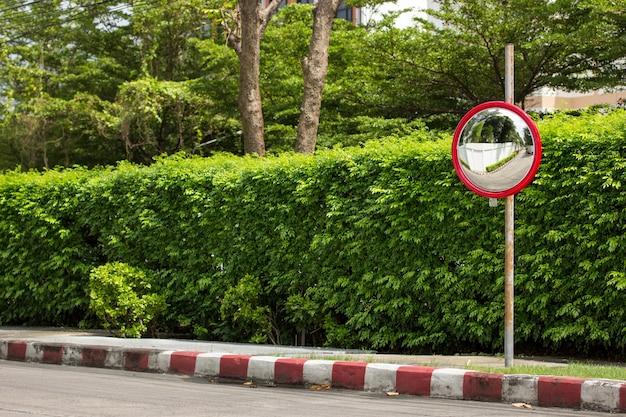 Traffic convex mirror at corner of street Free Photo