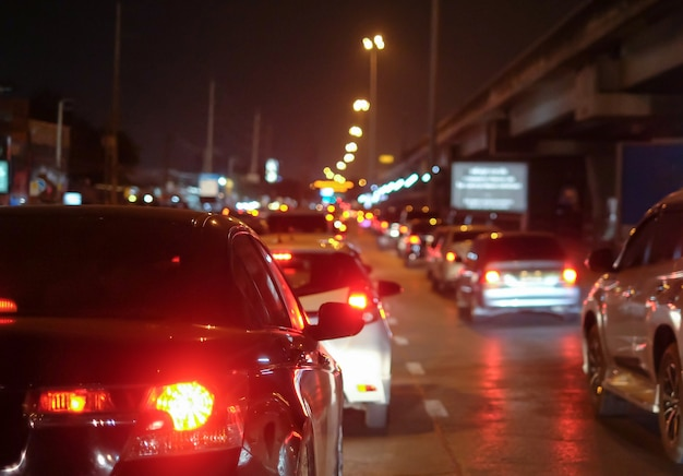 Traffic jams in city with row of cars on road at night Premium Photo