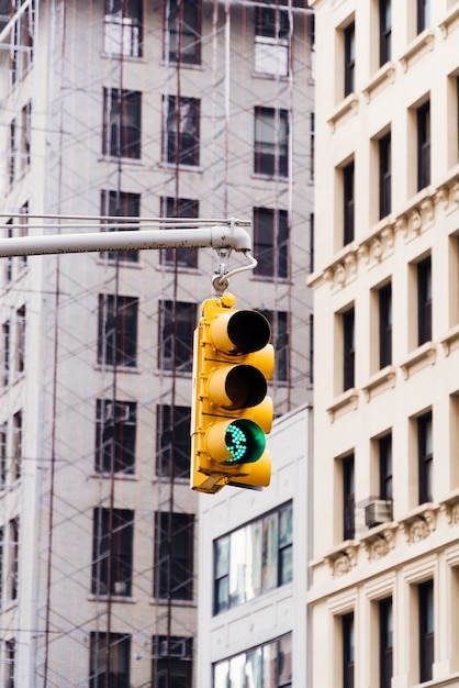 Traffic light on background of tall building Free Photo