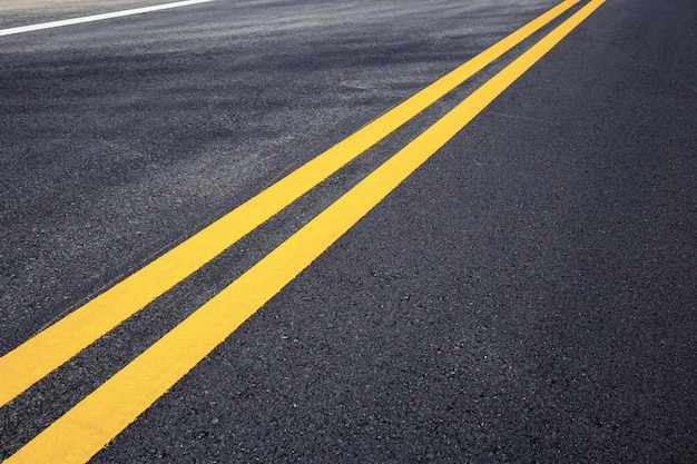 Traffic line of yellow on street. Premium Photo