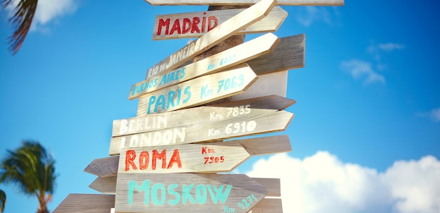 Traffic road  sign including moscow, roma,london,berlin,paris, rio de janeiro on blue sky background in retro style Free Photo
