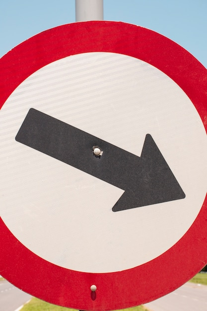 Traffic road sign with arrow outdoors Free Photo