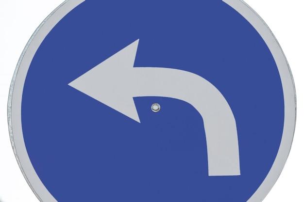 Traffic turn arrow sign close-up Free Photo