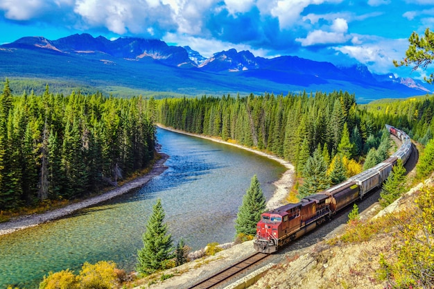 Train passing famous morant's curve at bow valley in autumn Premium Photo