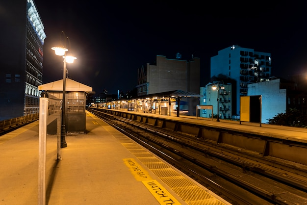 Train station in the city by night Free Photo