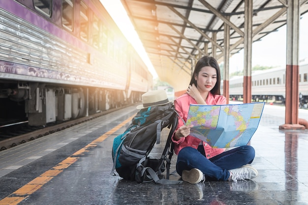 Train station with a traveler. travel concept. Premium Photo
