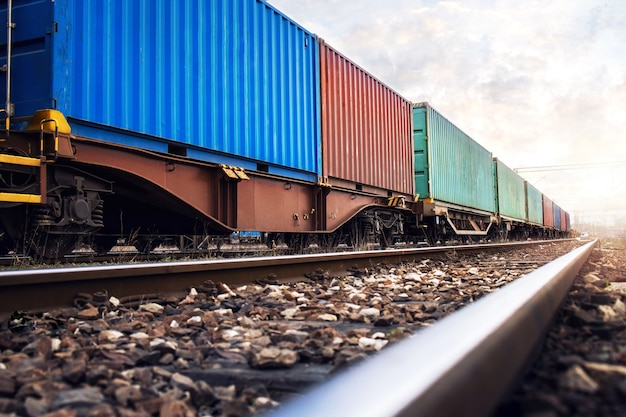 Train wagons carrying cargo containers for shipping companies Free Photo