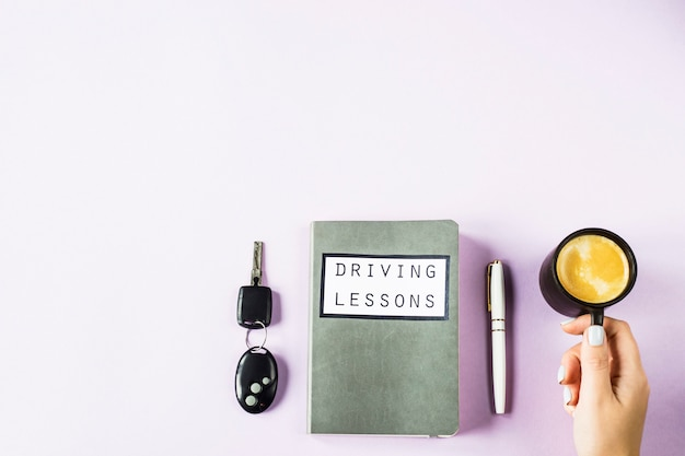 Training notebook for driving lessons and studying the rules of the road for obtaining a driver's license Premium Photo