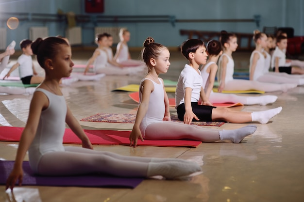 The training of young dancers in the ballet studio. Premium Photo