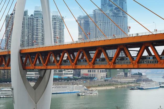 Trains run through the yangtze river bridge in chongqing, china Premium Photo