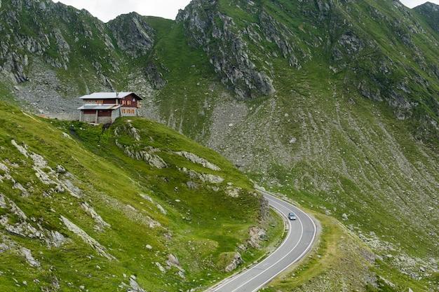 Transfagarasan mountain road with small building on rock, romanian carpathians Premium Photo
