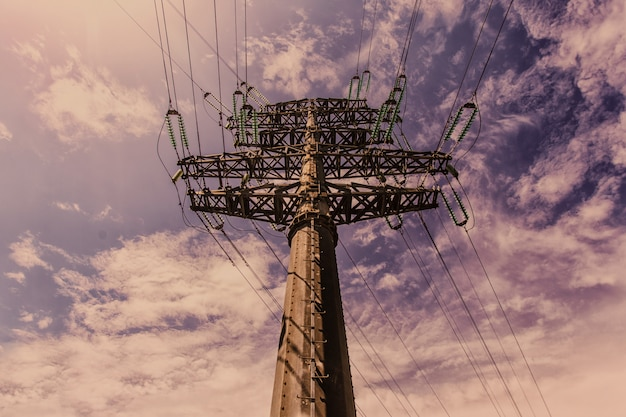 Transmission tower (power tower, electricity pylon, steel lattice tower) at twilight in us. texture high voltage pillar, overhead power line, industrial background. copy space Premium Photo