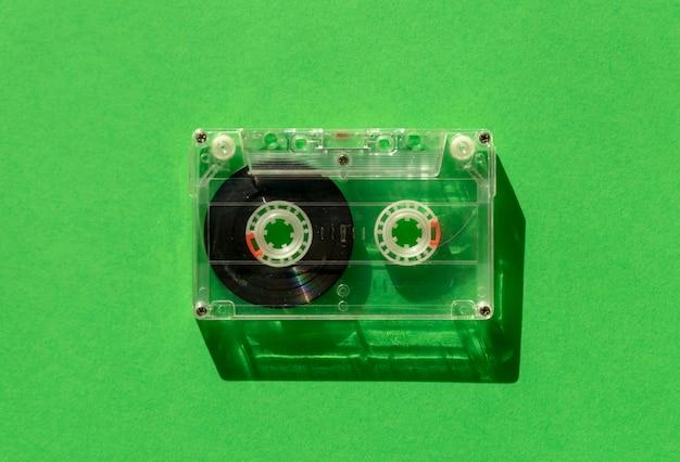 Transparent audio cassette tape on green Premium Photo