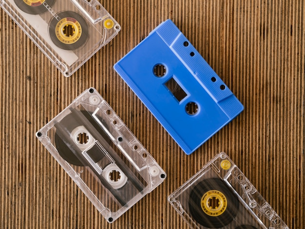 Transparent cassett tapes with blue one top view Free Photo