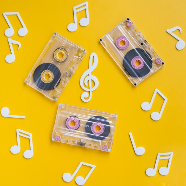 Transparent cassette tapes collection with musical notes around Free Photo