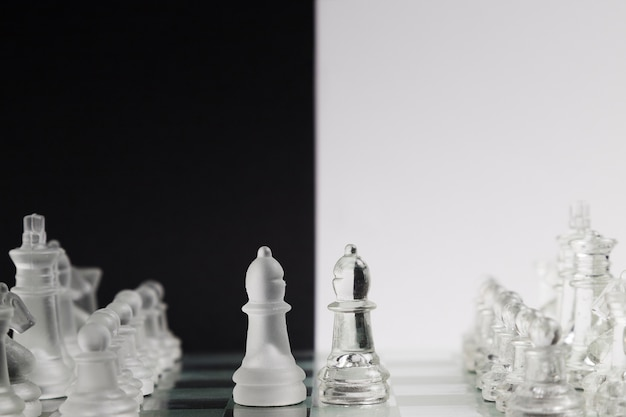 Transparent chess pieces on board Free Photo