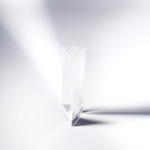 Transparent crystal prism on white background Free Photo