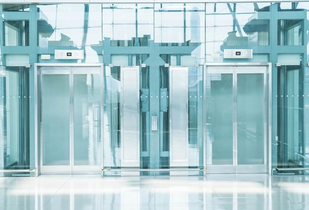Transparent elevator in underground passage Free Photo