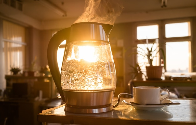 A transparent kettle of water boils against the of the sunset shining through the window Premium Pho