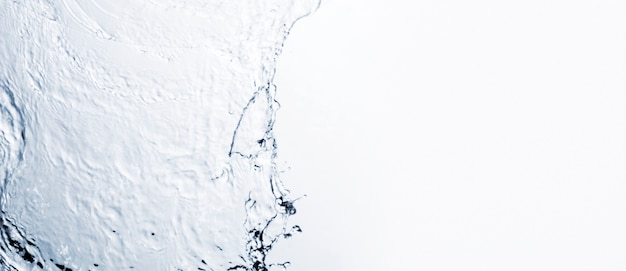 Transparent liquid shape on white background with copy space Free Photo