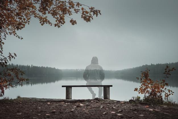 https://image.freepik.com/free-photo/transparent-man-is-sitting-bench-looking-lake-back-view-autumn-theme_183270-63.jpg
