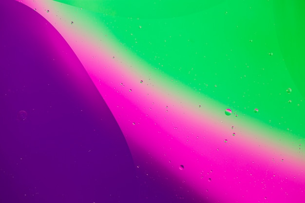 Transparent oily bubbles on vibrant copy space watery background Free Photo