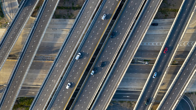 Transport city junction road with car on intersection cross road shot by drone Premium Photo