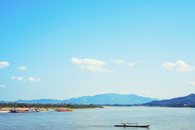Transportation boat on khong river in border of thai and laos with beautiful sky. Premium Photo