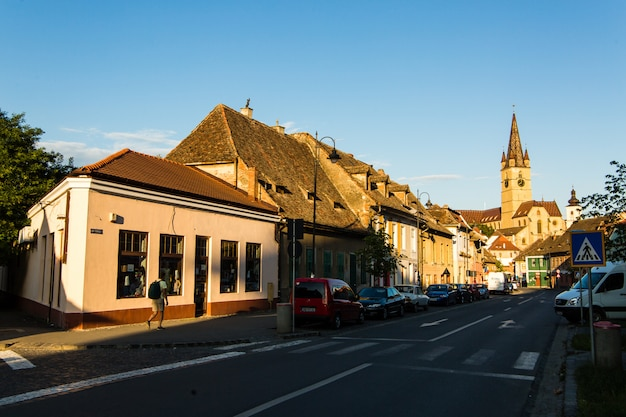 Transylvania. lutheran church, built in the huet square, seen from the streets of medieval lower town city Premium Photo