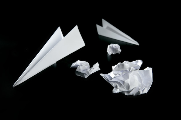 Trash paper and air plane Premium Photo