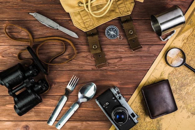 Travel accessories and eating utensil on table Free Photo